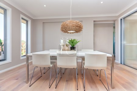 Luxury dining room and a light color wooden floor ...