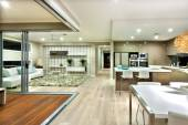 Modern house interior panorama with kitchen and the living room