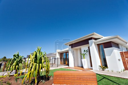 Residential area with luxurious houses and gardens in the clear