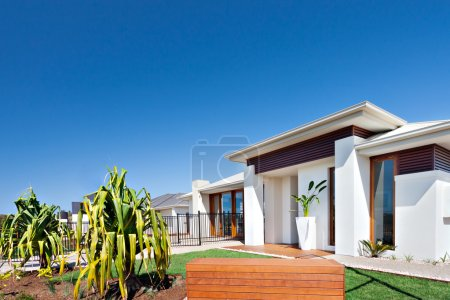 A residential area with luxurious houses and gardens in the clea