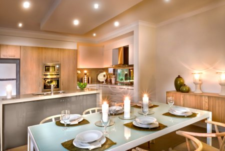 Luxury dining room and kitchen area decorated with flashing cand