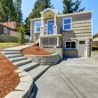 Clapboard sidinig house with walkout deck and conc...