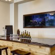 Soft ivory bar room with built in the wall aquariu...