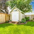Beautiful new shed with flower bed on backyard are...