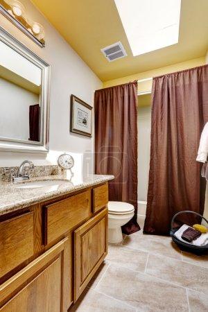 Bathroom interior with skylight