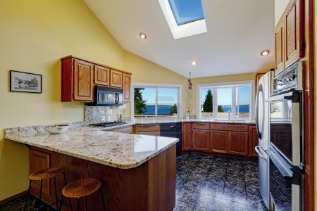 Beautiful kitchen room with skylight granite tile floor
