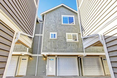 Light olive house in clapboard siding trim