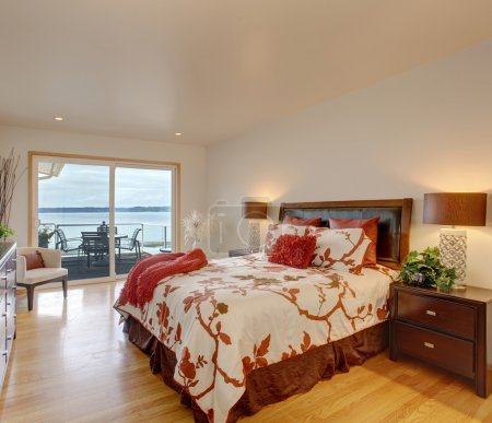 Romantic master bedroom interior with walkout deck