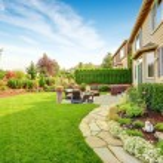 Impressive backyard landscape design with cozy pat...