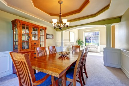 Luxury dining room with white columns and coffered ceiling