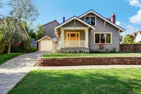 House exterior with front yard landscape. White en...