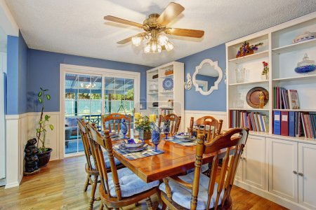 Photo for Beautifully decorated dinning room with sliding glass door and dinning set. - Royalty Free Image