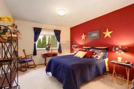 American themed guest bedroom with red wall.