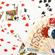 Playing cards with chips, banknotes and dice, gamb...
