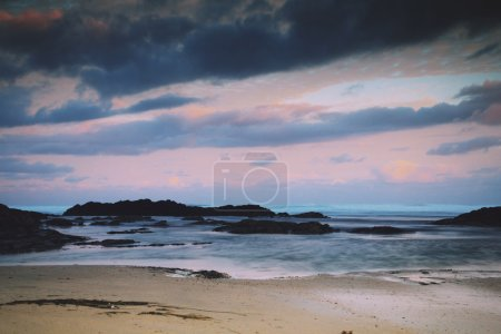 Early morning view of the beach at Polzeath Vintage Retro Filter