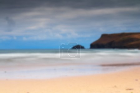 Early morning view of the beach at Polzeath Out of focus.