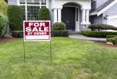 Modern Home for Sale with sign in front yard