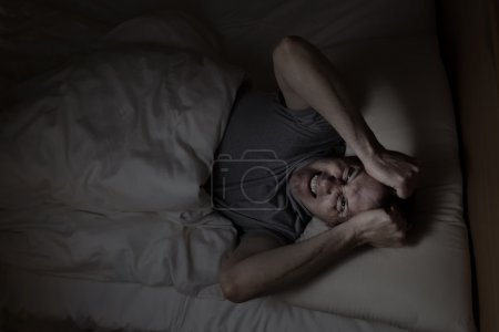 Photo for Top view image of mature man showing anger from insomnia - Royalty Free Image