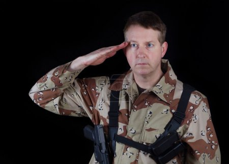 Male Soldier giving salute while under arms