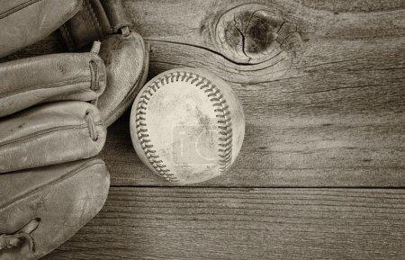 Vintage baseball Equipment on Rustic Wood