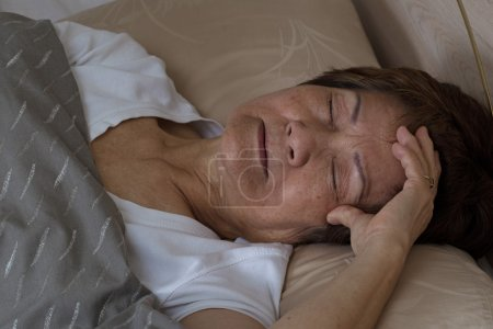 Photo for Close up of senior woman, eyes close, trying to fall asleep. Insomnia concept. - Royalty Free Image