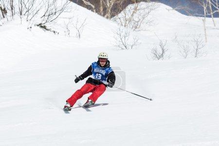 Skier rides steep mountains. Kamchatka Peninsula, Far East, Russia