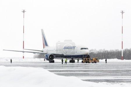 Airdrome trucks pulling Boeing-767 Transaero Airlines at airport of Petropavlovsk-Kamchatsky (Yelizovo airport). Kamchatka, Russia