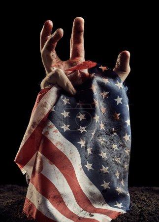 American flag in human hand