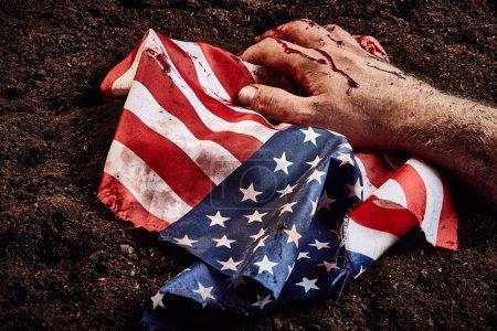 human hand on american flag