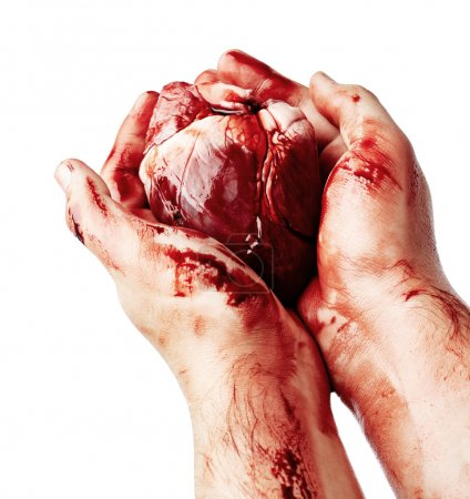 Bloody heart in human hand s
