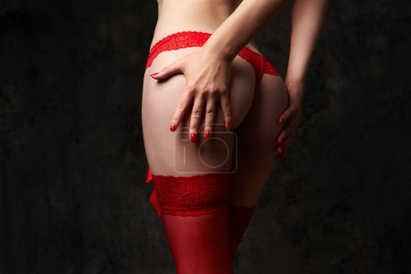 Woman's ass in red lace panty
