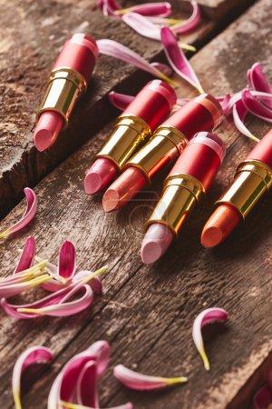 Lipsticks with flower petals