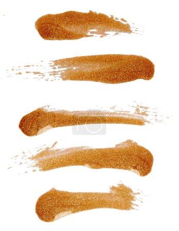 Strokes of golden nail polish