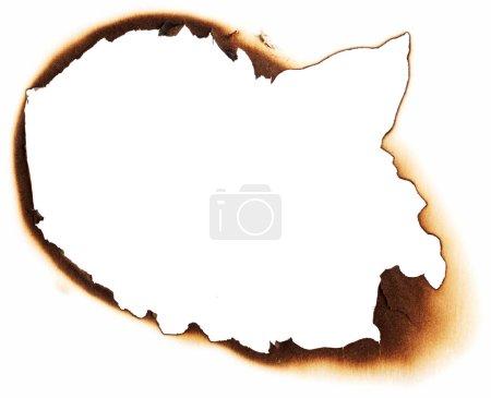 Photo pour Trou brûlé de papier blanc - image libre de droit
