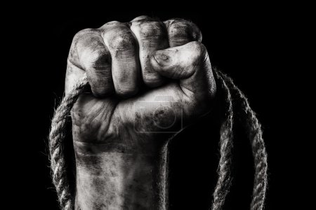 Rope in male hand.