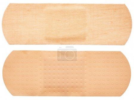 Adhesive plasters on white background