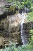 Beautiful waterfall falling off a cliff, Chegem Gorge,  Caucasus