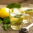 Fresh Green Tea with Lemon in Transparent Cups, He...