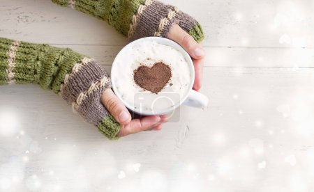 Holding Coffee Latte with Cozy Hand Warmers on Magic Background