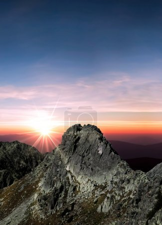 Photo for Sun is shining over the mountain peak - Royalty Free Image