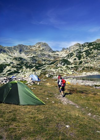 Photo for Camping in mountains, tents and mountaineers - Royalty Free Image