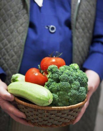 Photo for Female farmer holding vegetable basket - Royalty Free Image