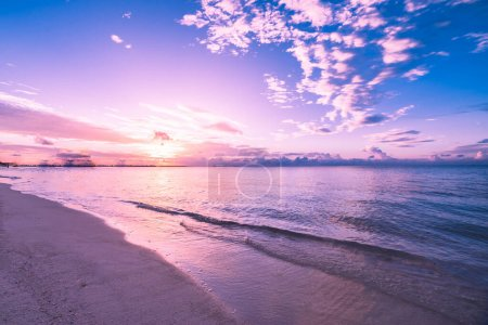 Photo for Closeup of sea beach and colorful sunset sky. Panoramic beach landscape. Empty tropical beach and seascape. Pink purple sunset sky, soft sand, calmness, tranquil relaxing sunlight, summer mood. Dream beach, motivation and inspiration nature scenery - Royalty Free Image