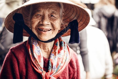 Undefined old woman portrait in Ha long city