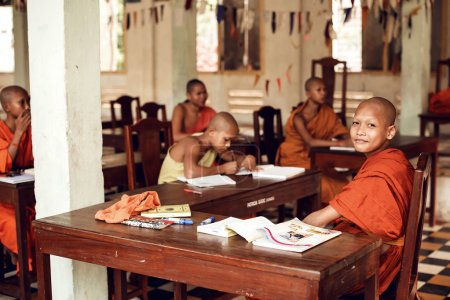 Buddhist monks learning on classroom