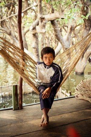 Portrait of an unidentified Khmer boy on Tonle Sap Lake in Kampong Phluk