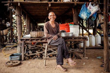 Portrait of an unidentified asian man on Tonle Sap Lake