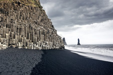 The black sand beach of Reynisfjara and the mount ...