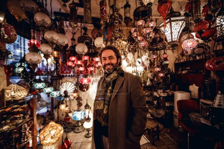 Man in shop of traditional lamps