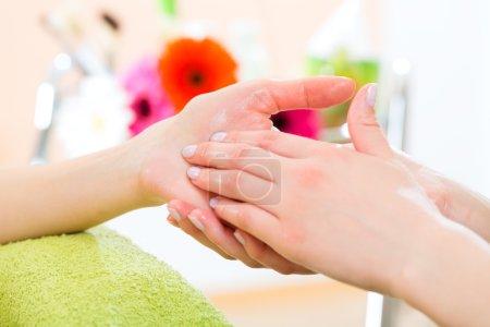 Woman  receiving hand massage
